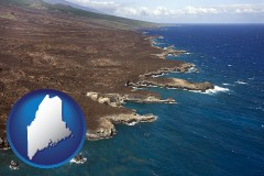 maine map icon and an aerial photograph of a Hawaiian shoreline