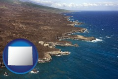 wyoming map icon and an aerial photograph of a Hawaiian shoreline