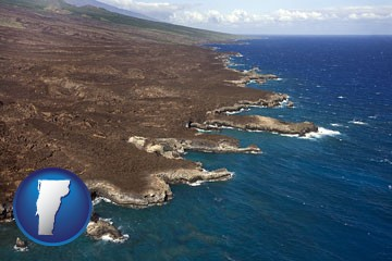 an aerial photograph of a Hawaiian shoreline - with Vermont icon