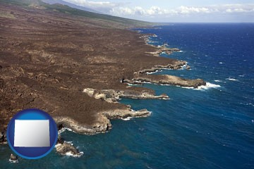 an aerial photograph of a Hawaiian shoreline - with Wyoming icon
